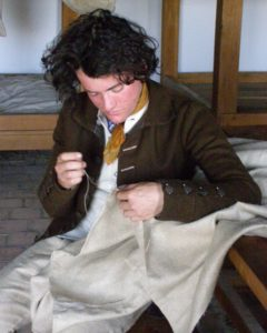 Soldier mending sail cloth