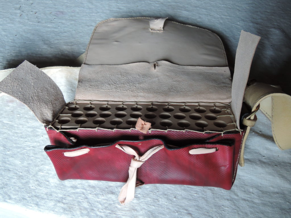Red-colored leather Giberne with wooden cartidge block