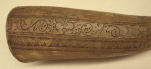 Robert Fairchild's powder horn scroll and geometric shape detail