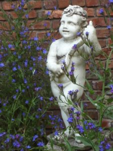 Cupid among flowers