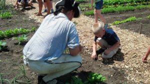 Cam w kid in garden