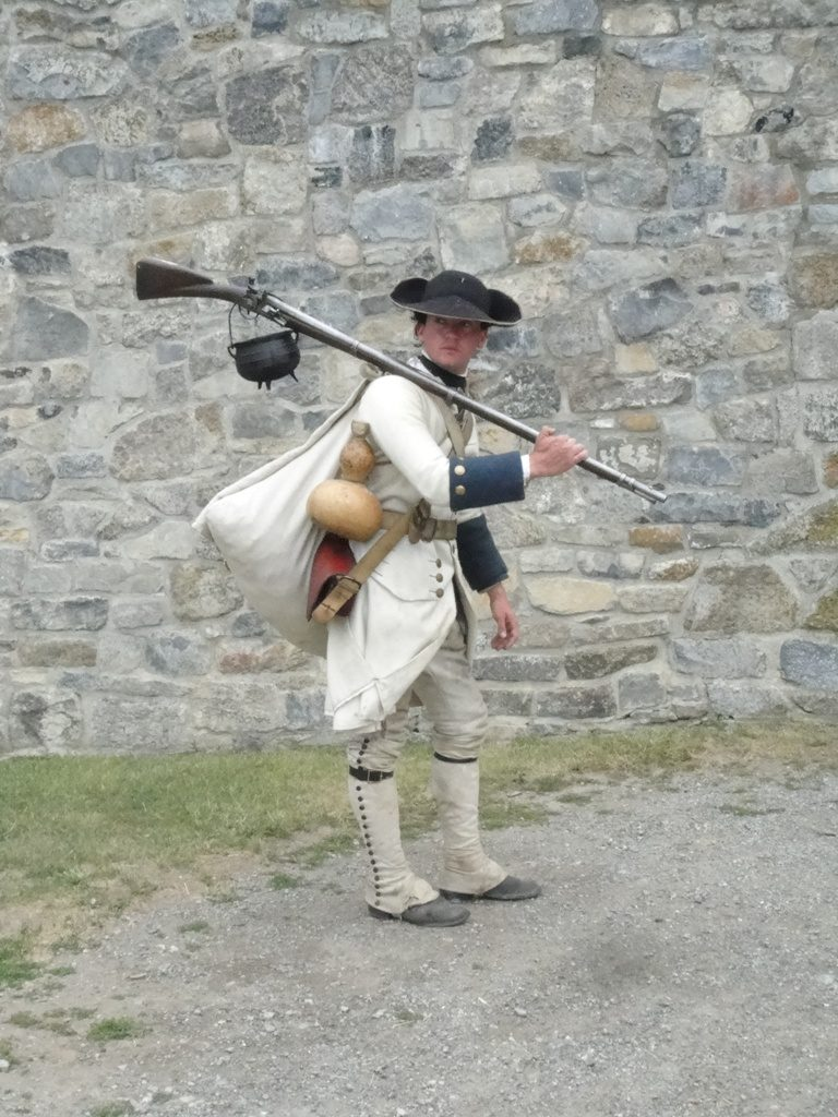 Soldier carrying a gran haversac and gun