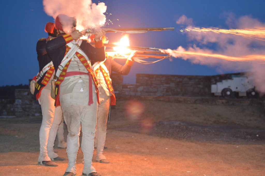 Soldiers firing guns during Guns by Night