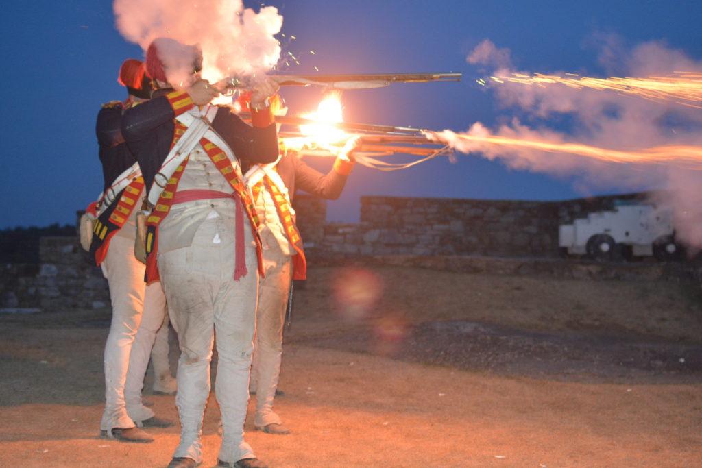 Soldiers firing guns during Guns by Night