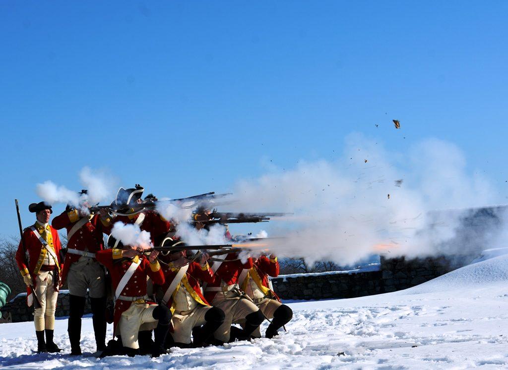 Soldiers firing guns