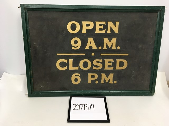 Open 9 A.M. Closed 6 P.M. sign
