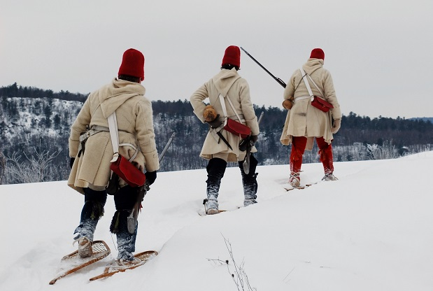French soldiers using snowshoes to travel