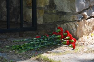 Flowers next to memorial