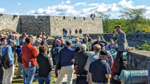 Group listening to speaker during Defend the Fort tour