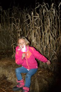 Little girl participating in Maze by Midnight