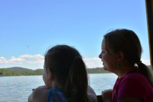 Girls looking over edge of Carillon boat