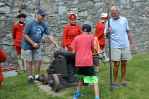 Group practicing steps to load and fire cannons