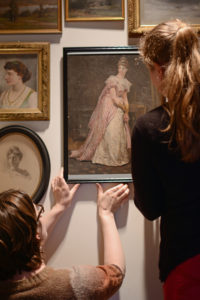 Anna and Collections Department team member, Tabitha Hubbard, preserving paintings