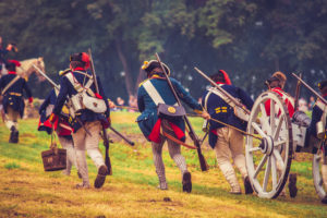 Soldiers dragging cannon up hill during Brown's Raid 1777 battle re-enactment