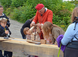 Carpenter teaching young children