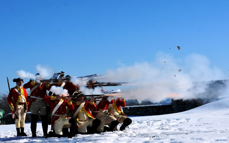 British Garrison soldiers firing muskets on a beautiful winter day