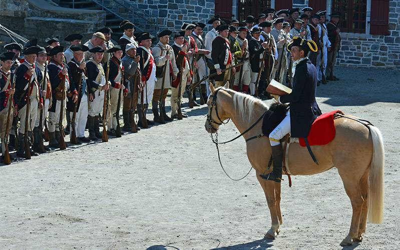 Soldier on horse in front of other soldiers
