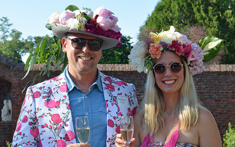 Man and women wearing flower hats at King's Garden