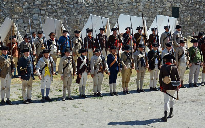 Reenacters standing in formation