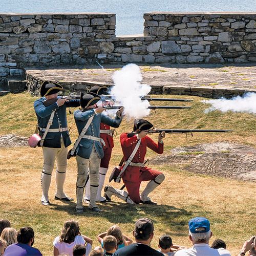 http://Men%20firing%20rifles%20during%20battle%20reenactment