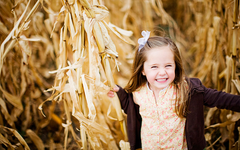 Girl running through corn maze