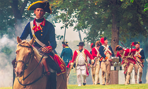 http://Man%20on%20horse%20with%20soldiers%20in%20the%20background