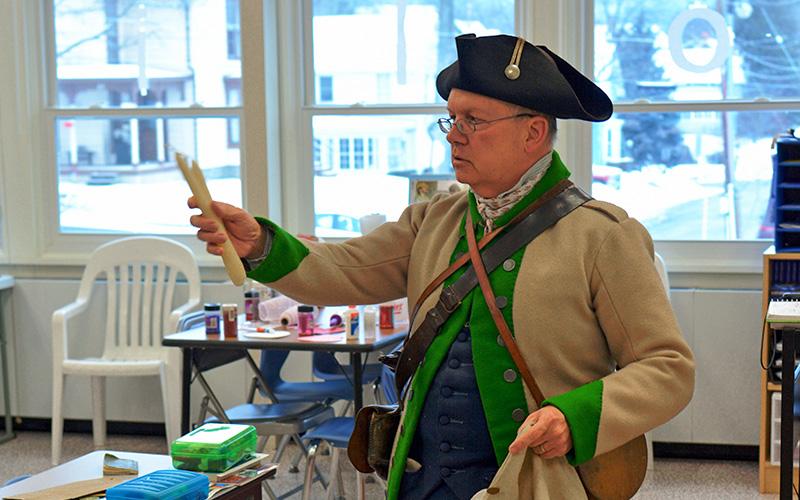 Re-enactor teaching in classroom