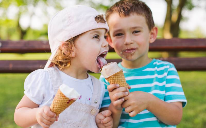 brother and sister eating ice cream