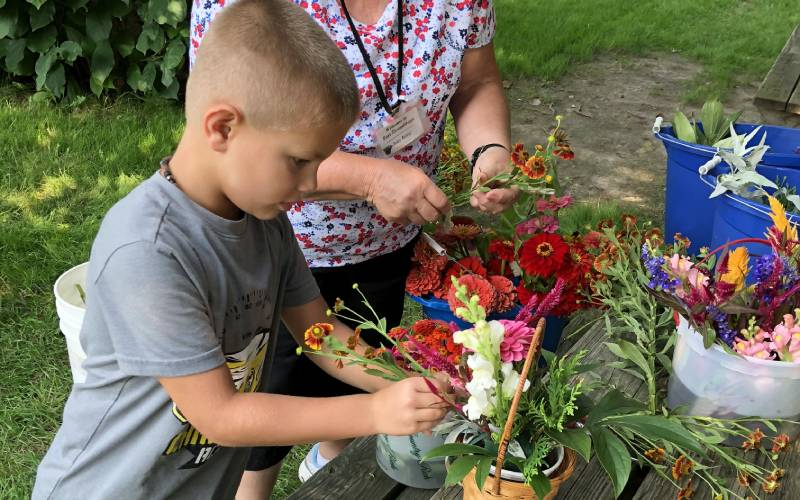 boy making flower arrangement