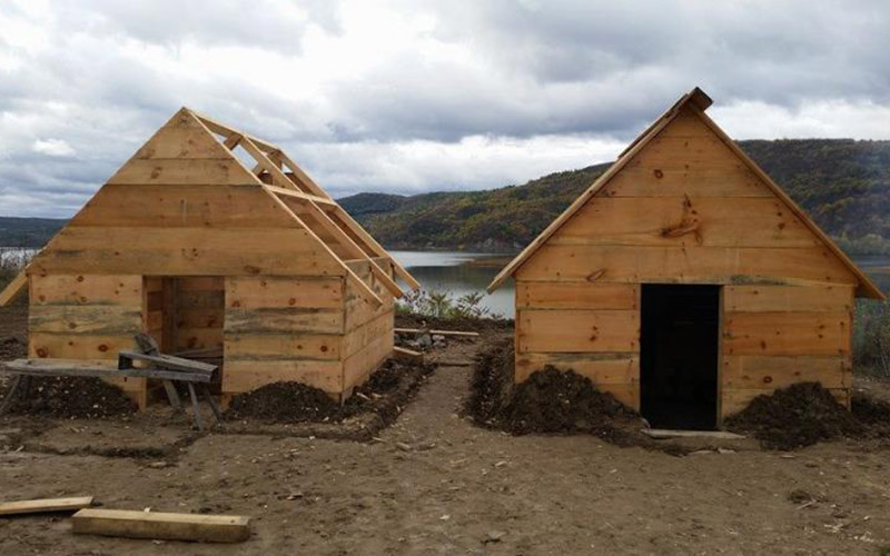 2 wooden huts