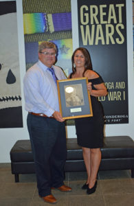 Tim Stocker on behalf of International Ticonderoga Mill and the International Paper Foundation receives Henry Knox award during the Annual Summer Gala on August 10, 2019 presented by Beth Hill, Fort Ticonderoga President & CEO.