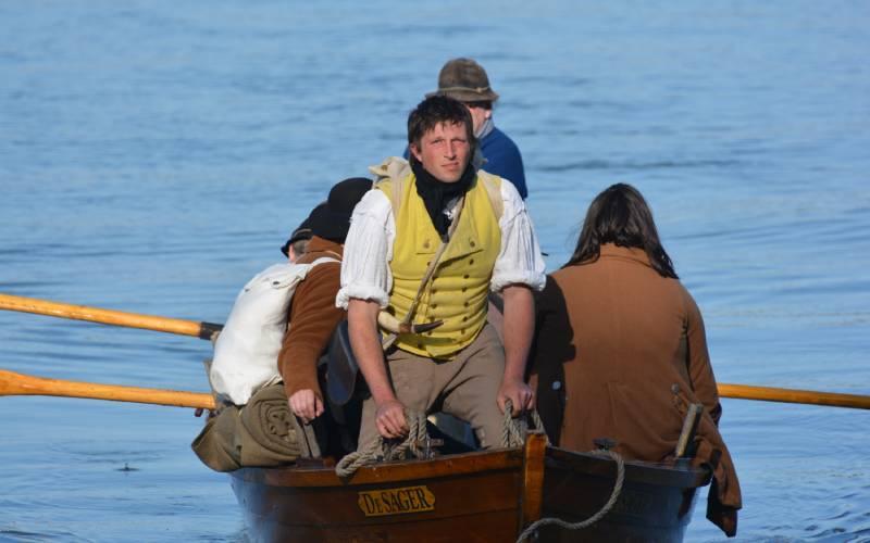 reenactors on a boat