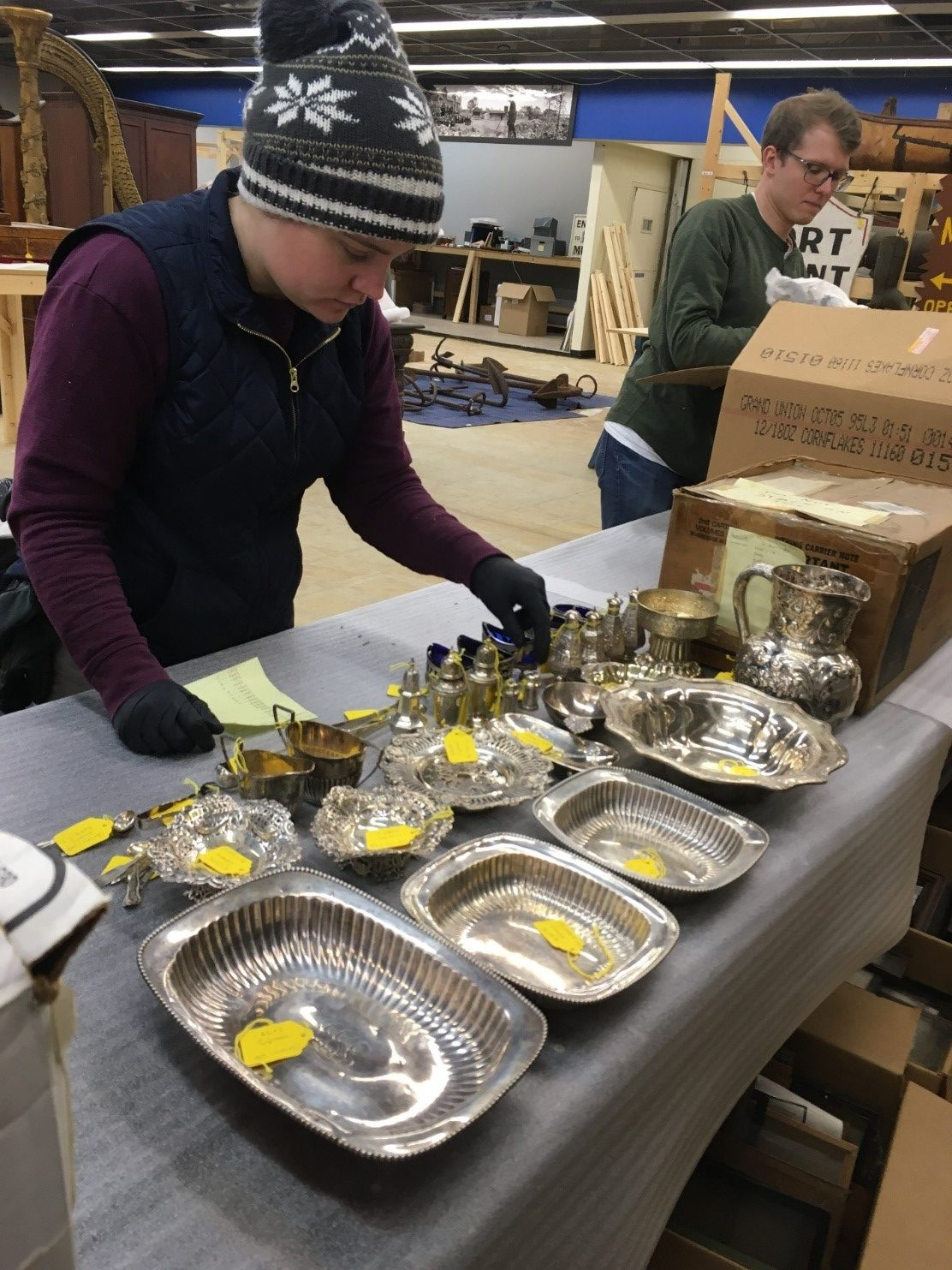 Collections staff begin the process of unpacking and sorting the silver collection