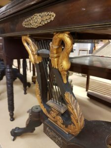 The legs, swan lyre support, and applied ormolu mounts of this game table are distinguishing details in this game table historically attributed to Duncan Phyfe.