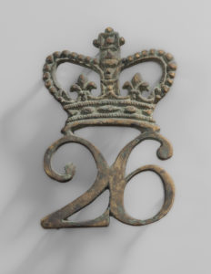 The badge of the 26th Regiment would have been a familiar site to the colonists of the mid-Atlantic, by the time they left New York City in 1772. Elements of the regiment returned to New York in 1776, when the prisoners captured in Canada in 1775 were released and re-joined the British army. (Fort Ticonderoga Museum Collection, 2019.5.5, photo: Gavin Ashworth)