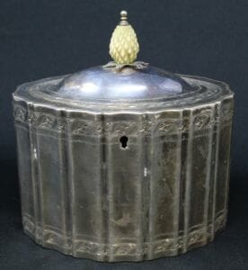 This Federal-style tea caddy was made by London silversmith Michael Plummer in 1795. Clean lines and restrained decorations influenced by ancient Greece and Rome are hallmarks of this style.