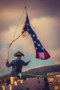 soldier taking down flag