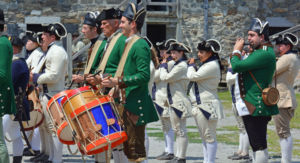 fife and drum players performing
