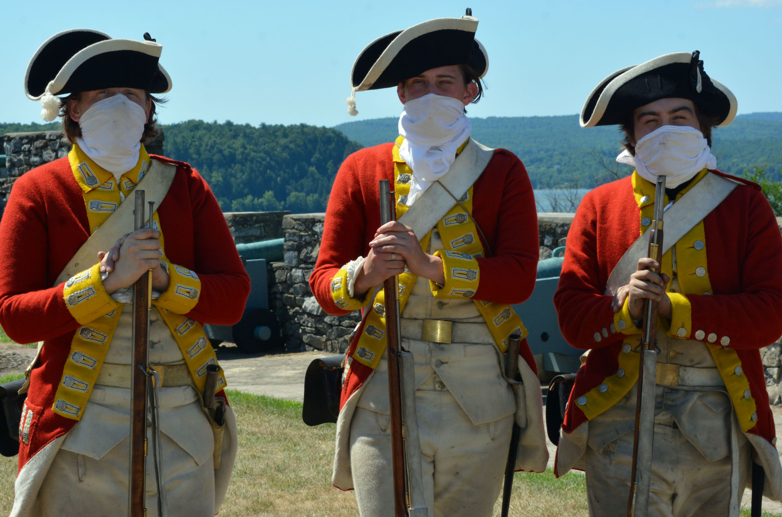 Fort Ticonderoga staff in 18th cent dress with muskets