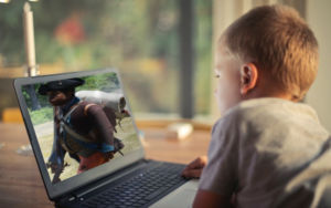 child looking at laptop