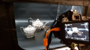 A teapot, sugar bowl, and creamer passed down through the Pell family. The teapot was made by J & A Simmons, silversmiths active in New York City between 1802 and 1814.