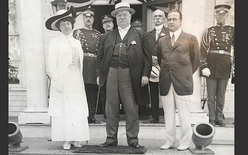 Sarah Pell and others in front of Pavilion