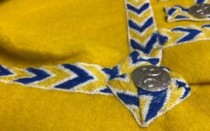 close up of drummer's lace on yellow uniform